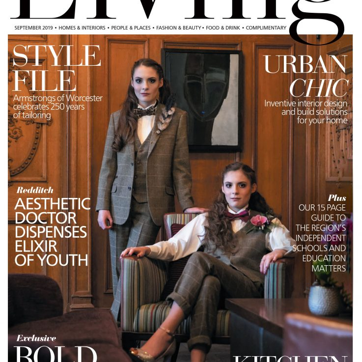 Front cover of Midlands Living magazine of twins dressed in suits